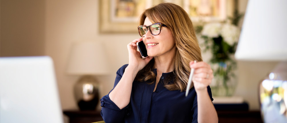 female accountant talking to a prospect on the phone