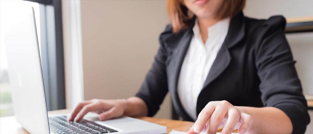 working female accountant with black blazer