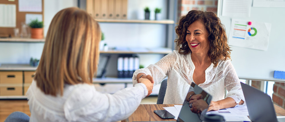 female tax professional shaking hands with a new client