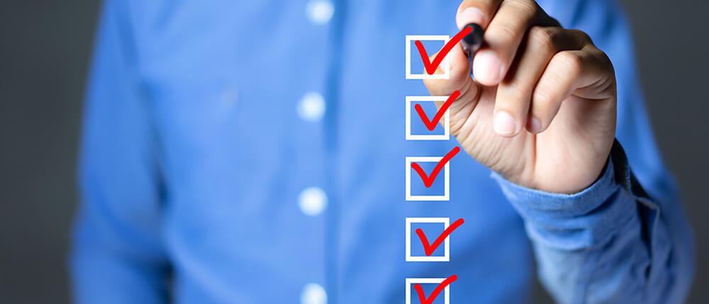 accountant checking off items on checklist